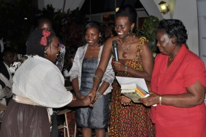 Betty Kituyi, receiving the Third Prize for BN Poetry Awards Uganda, 2012
